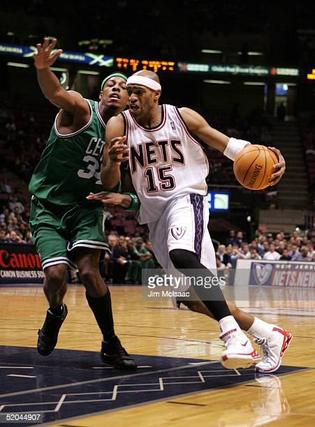 Vince Carter of the New Jersey drives to the basket against Paul Pierce of the Boston Celtics Nets January 21, 2005 at Continental Airlines Arena in...