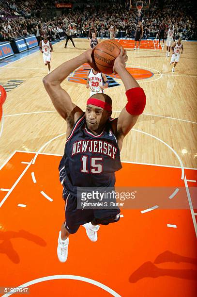 Vince Carter of the New Jersey Nets attempts to dunk against the New York Knicks at Madison Square Garden on January 1 2005 in New York City NOTE TO...