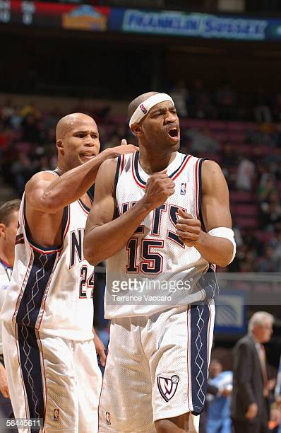 Vince Carter of the New Jersey Nets celebrates with teammate Richard Jefferson at the Continental Airlines Arena on December 16 2005 in East...