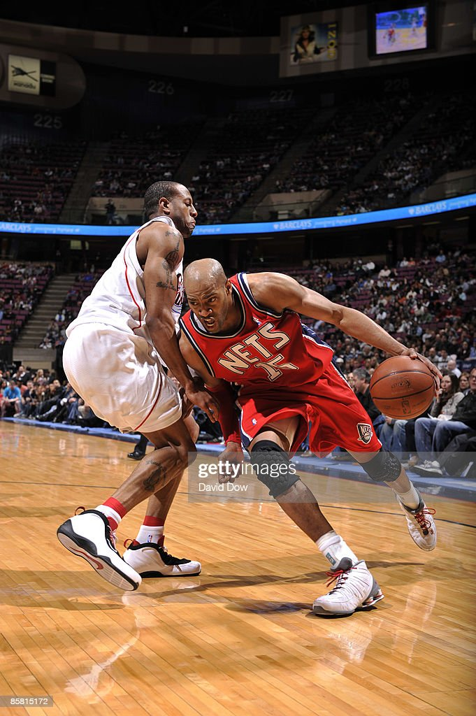 Vince Carter of the New Jersey Nets drives against Andre Iguodala of ... 0b2ac1281