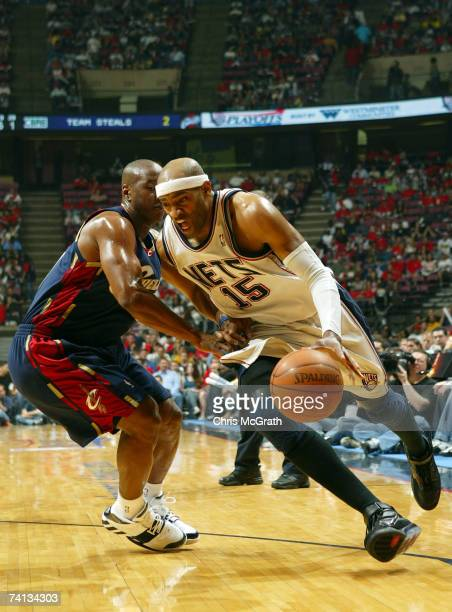 Vince Carter of the New Jersey Nets drives against Eric Snow of the Cleveland Cavaliers during Game Three of the Eastern Conference Semifinals during...