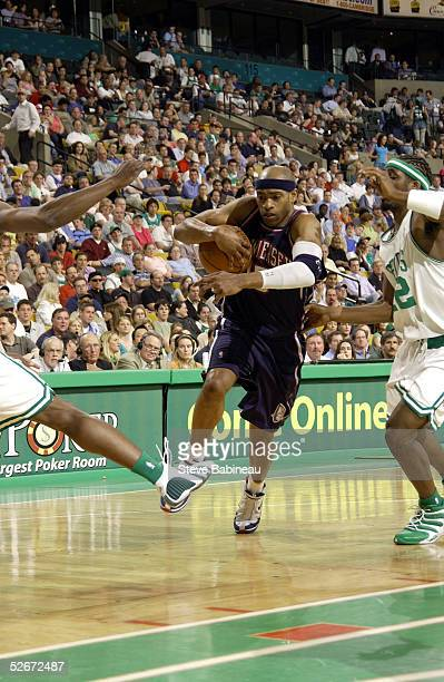 Vince Carter of the New Jersey Nets drives against the Boston Celtics on April 20 2005 at the Fleet Center in Boston Massachusetts NOTE TO USER User...