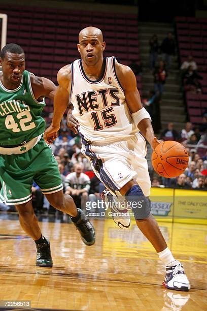 Vince Carter of the New Jersey Nets drives against Tony Allen the Boston Celtics on October 24 2006 at Continental Airlines Arena in East Rutherford...