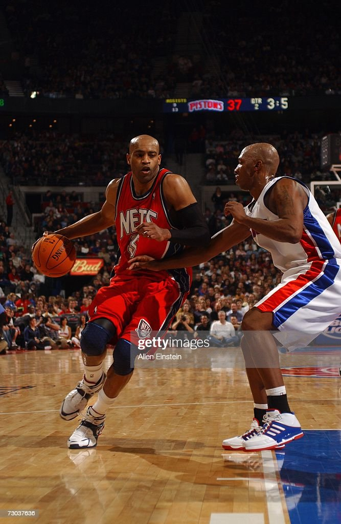 Vince Carter #15 of the New Jersey Nets drives to the basket against Chauncey Billups #1 of the Detroit Pistons during a game at the Palace of Auburn Hills on December 26, 2006 in Auburn Hills, Michigan. The Pistons defeated the Nets 92-91.