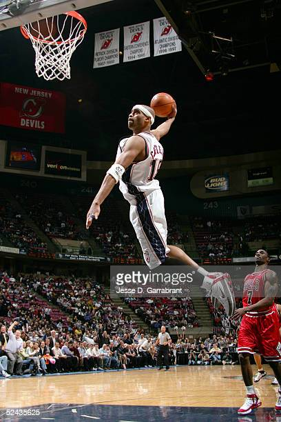 Vince Carter of the New Jersey Nets drives to the hoop past Ben Gordon of the Chicago Bulls on March 16 2005 at the Continental Airlines Arena in...