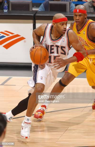 Vince Carter of the New Jersey Nets drives to the lane against Al Harrington of the Atlanta Hawks during a game on January 17 2005 at Philips Arena...