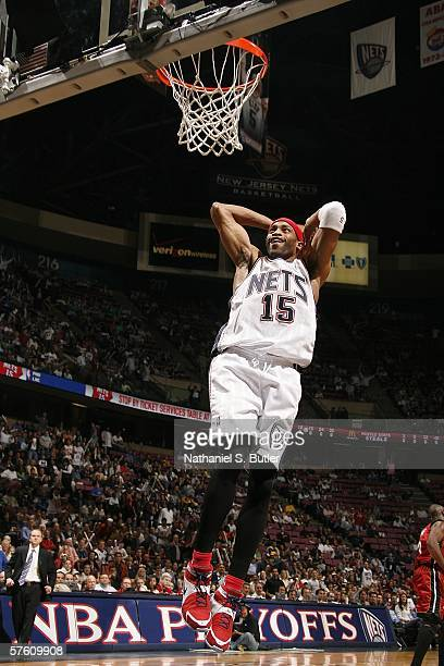 Vince Carter of the New Jersey Nets dunks against the Miami Heat in game four of the Eastern Conference Semifinals during the 2006 NBA Playoffs on...