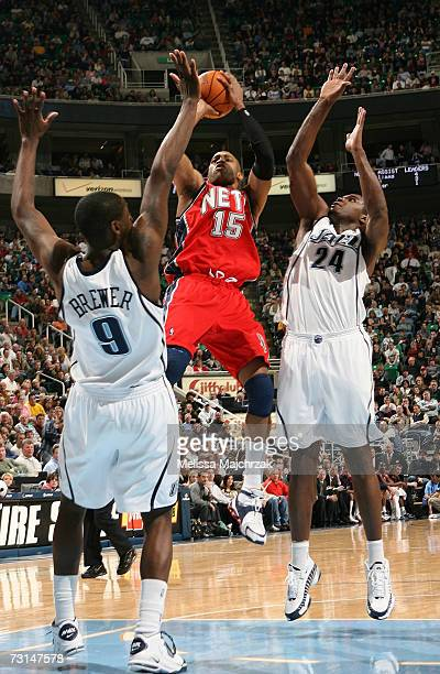 Vince Carter of the New Jersey Nets goes up for the shot against Ronnie Brewer and Paul Millsap of the Utah Jazz on January 29 2007 at the...