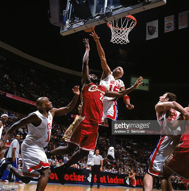 Vince Carter of the New Jersey Nets goes up to block a shot against LeBron James of the Cleveland Cavaliers during a game at Continental Airlines...