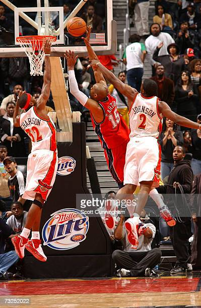 Vince Carter of the New Jersey Nets hits the gamewinning shot against Jeremy Richardson and Joe Johnson of the Atlanta Hawks on February 7 2007 at...