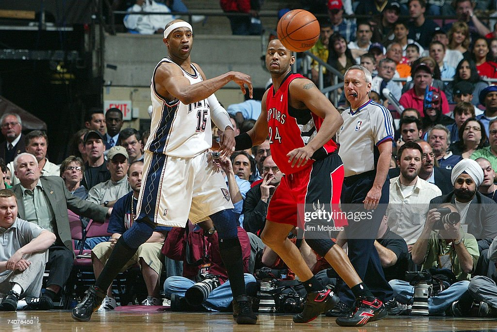 38b7c33cf Vince Carter of the New Jersey Nets passes against Morris Peterson ...