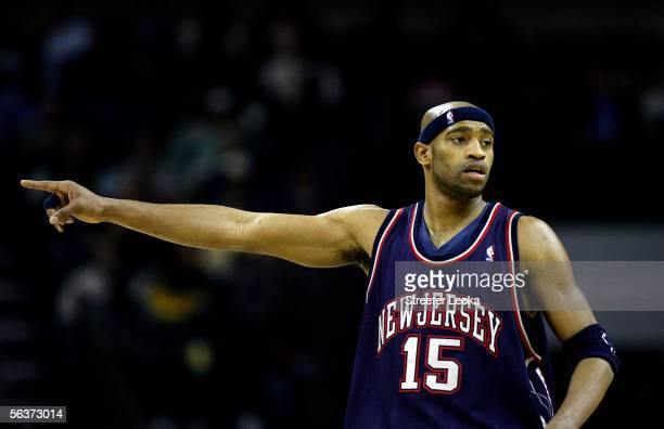 Vince Carter of the New Jersey Nets points to his teammates during their game against the Charlotte Bobcats during their game on December 7 2005 at...