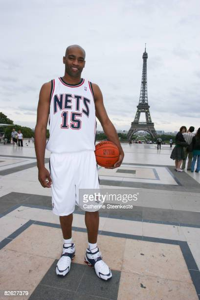 Vince Carter of the New Jersey Nets poses in front of the Eiffel Tower during a promotion for the 2008 NBA Europe Live Tour on September 2, 2008 in...