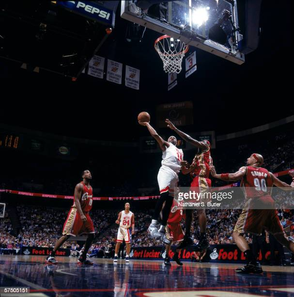 Vince Carter of the New Jersey Nets puts a shot up against LeBron James of the Cleveland Cavaliers at Continental Airlines Arena in East Rutherford,...