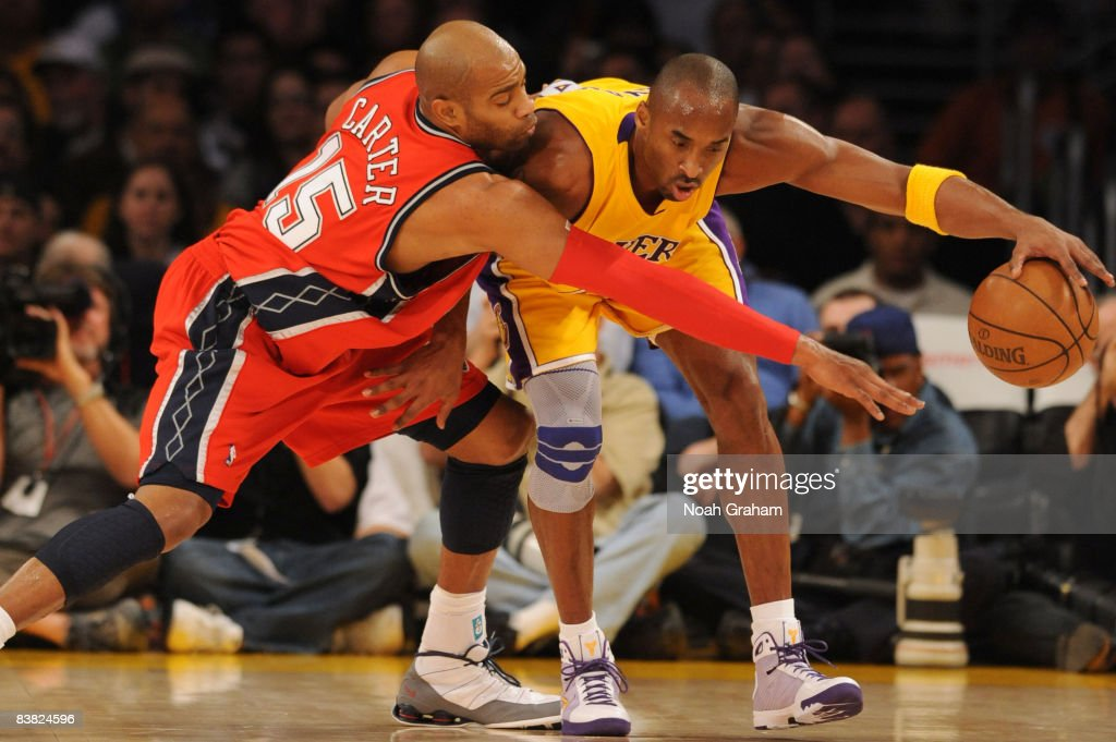 Vince Carter #15 of the New Jersey Nets reaches for the ball against Kobe Bryant #24 of the Los Angeles Lakers at Staples Center on November 25, 2008 in Los Angeles, California.