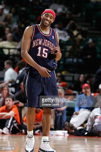 Vince Carter of the New Jersey Nets reacts after a win over the Charlotte Bobcats in NBA action March 28 2005 at the Charlotte Coliseum in Charlotte...