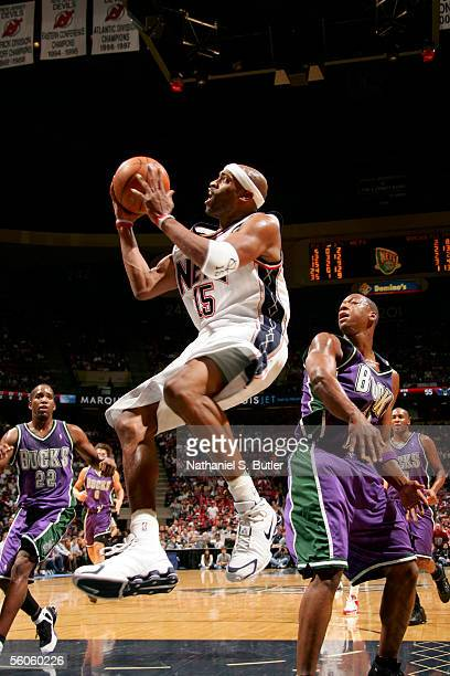 Vince Carter of the New Jersey Nets shoots against Bobby Simmons of the Milwaukee Bucks at the Continental Airlines Arena on November 2 2005 in East...