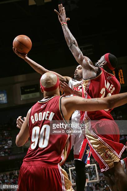 Vince Carter of the New Jersey Nets shoots against LeBron James and Drew Gooden the Cleveland Cavaliers during the game at Continental Airlines Arena...