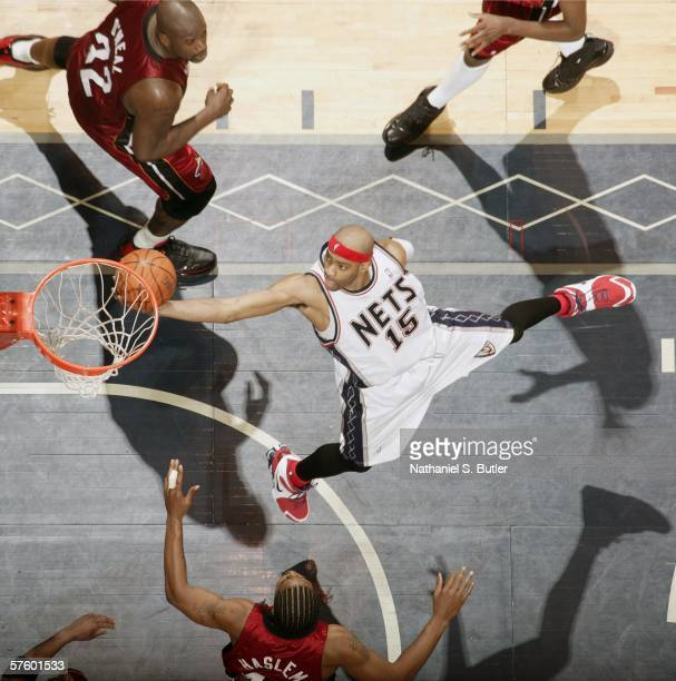 Vince Carter of the New Jersey Nets shoots against Shaquille O'Neal of the Miami Heat in game three of the Eastern Conference Semifinals during the...