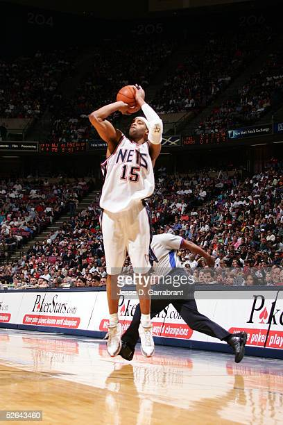 Vince Carter of the New Jersey Nets shoots against the Philadelphia 76ers on April 17, 2005 at the Continental Airlines Arena in East Rutherford, New...