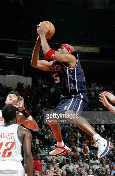 Vince Carter of the New Jersey Nets shoots the ball in NBA action against the Charlotte Bobcats March 28 2005 at the Charlotte Coliseum in Charlotte...