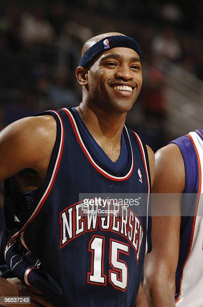 Vince Carter of the New Jersey Nets smiles as he stands on the court during a game against the Phoenix Suns at America West Arena on November 25,...