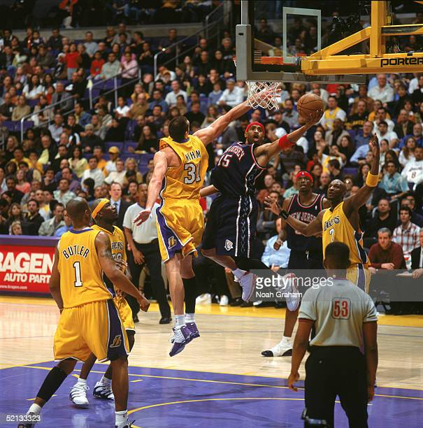 Vince Carter of the New Jersey Nets takes the ball to the basket against Chris Mihm of the Los Angeles Lakers during the game at Staples Center on...