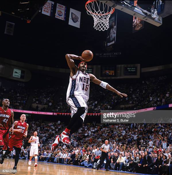 Vince Carter of the New Jersey Nets takes the ball to the basket against the Miami Heat in game three of the Eastern Conference Semifinals during the...