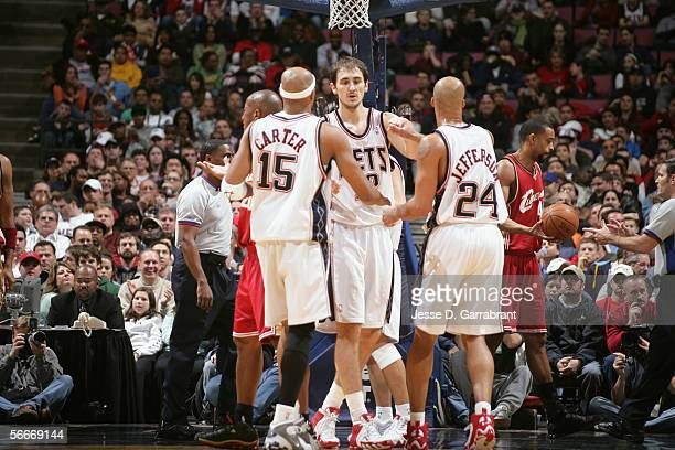 Vince Carter of the New Jersey Nets talks to his teammates Nenad Krstic and Richard Jefferson during the game against the Cleveland Cavaliers on...