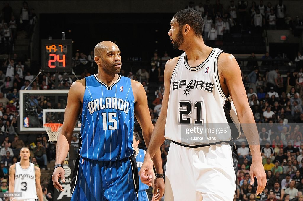 Vince Carter #15 of the Orlando Magic and Tim Duncan #21 of the San Antonio Spurs walk down the court during the game on April 2, 2010 at the AT&T Center in San Antonio, Texas. The Spurs won 112-100.
