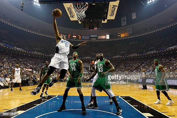 Vince Carter of the Orlando Magic drives for a shot attempt against Paul Pierce and Kendrick Perkins of the Boston Celtics in Game Two of the Eastern...