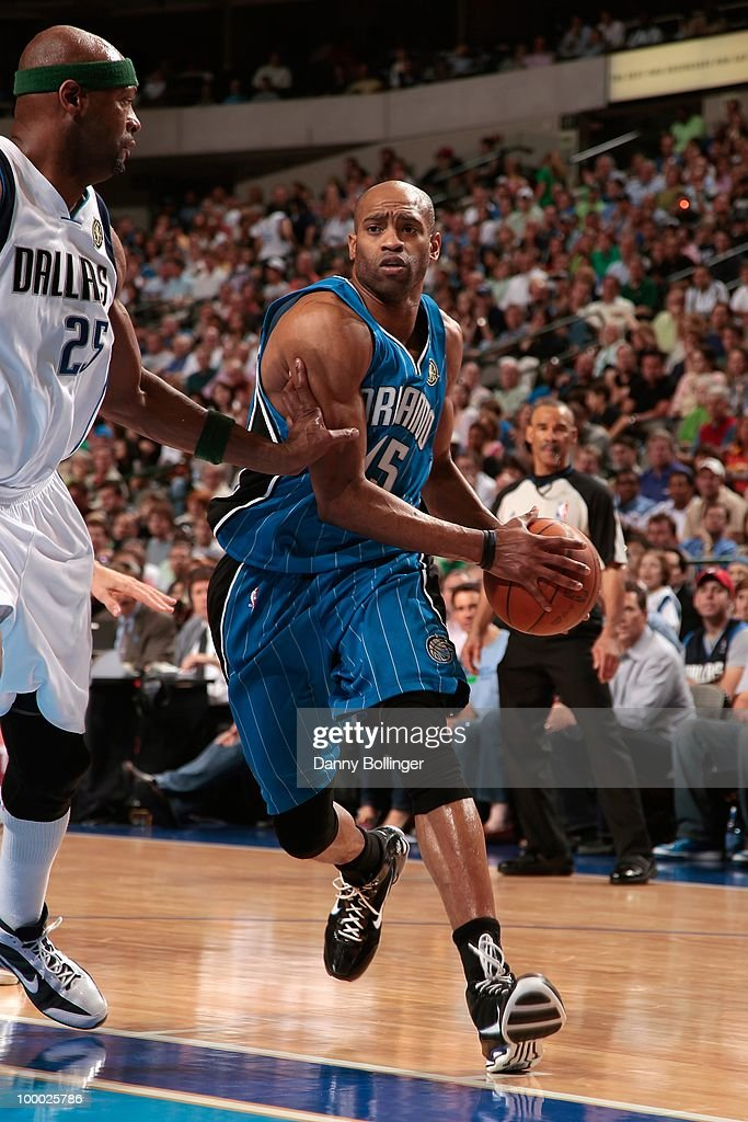 Vince Carter #15 of the Orlando Magic drives to the basket against Erick Dampier #25 of the Dallas Mavericks on April 1, 2010 at American Airlines Center in Dallas, Texas. The Magic won 97-82.