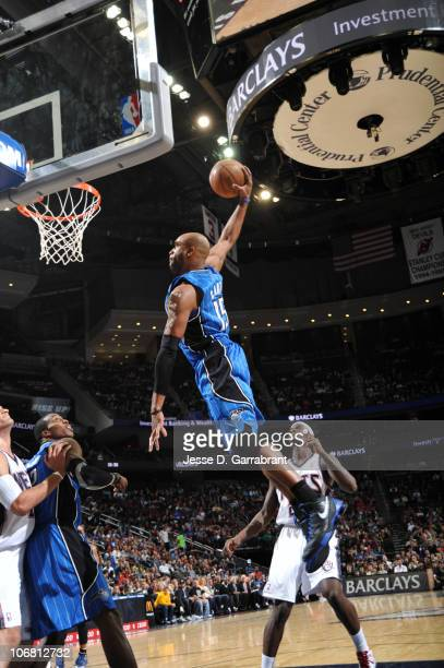 Vince Carter of the Orlando Magic dunks against Anthony Morrow of the New Jersey Nets during the game on November 13, 2010 at the Prudential Center...