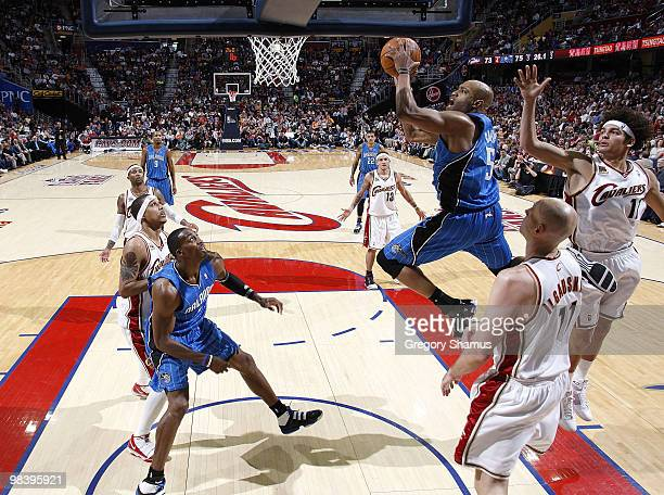 Vince Carter of the Orlando Magic gets to the basket between Anderson Varejao and Zydrunas Ilgauskas of the Cleveland Cavaliers on April 11 2010 at...