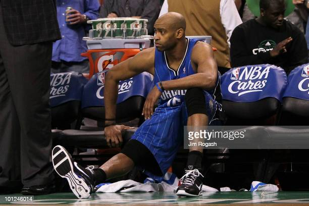 Vince Carter of the Orlando Magic looks on from the bench dejected after they lost 9684 against the Boston Celtics in Game Six of the Eastern...