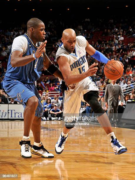 Vince Carter of the Orlando Magic moves the ball against Antawn Jamison of the Washington Wizards during the game on February 5 2010 at Amway Arena...