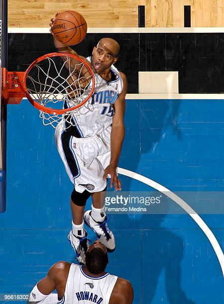 Vince Carter of the Orlando Magic takes the ball to the basket against the Toronto Raptors during the game on January 6, 2010 at Amway Arena in...