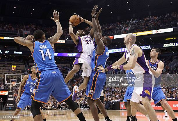 Vince Carter of the Phoenix Suns puts up a shot against Nazr Mohammed of the Oklahoma City Thunder during the NBA game at US Airways Center on March...