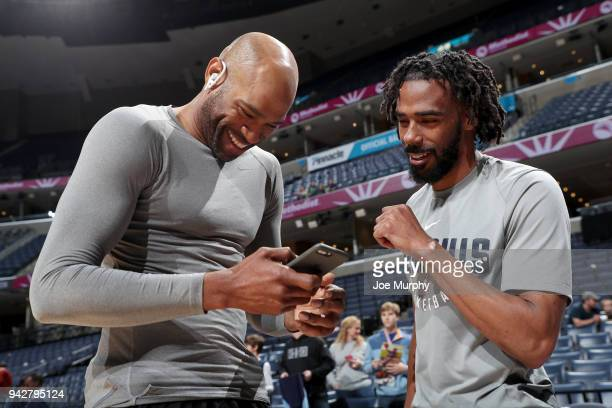 Vince Carter of the Sacramento Kings and Mike Conley of the Memphis Grizzlies talk before the game on April 6 2018 at FedExForum in Memphis Tennessee...
