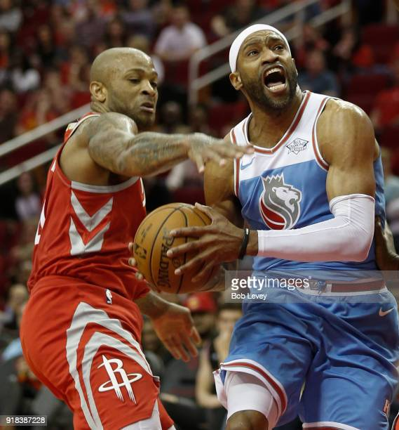 Vince Carter of the Sacramento Kings is fouled by PJ Tucker of the Houston Rockets as he goes to the basket at Toyota Center on February 14 2018 in...