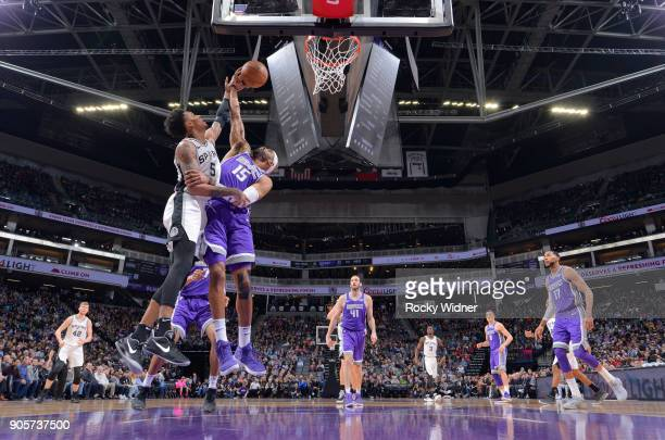 Vince Carter of the Sacramento Kings rebounds against Dejounte Murray of the San Antonio Spurs on January 8 2018 at Golden 1 Center in Sacramento...