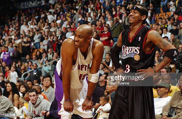 Vince Carter of the Toronto Raptors and Allen Iverson of the Philadelphia 76ers smile during a preseason game on October 13 2002 at Air Canada Centre...