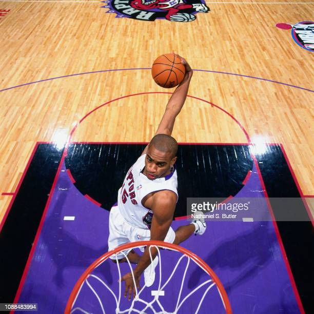Vince Carter of the Toronto Raptors attempts a dunk during a photo shoot on November 1 1999 at the Air Canada Centre in Toronto Ontario Canada NOTE...