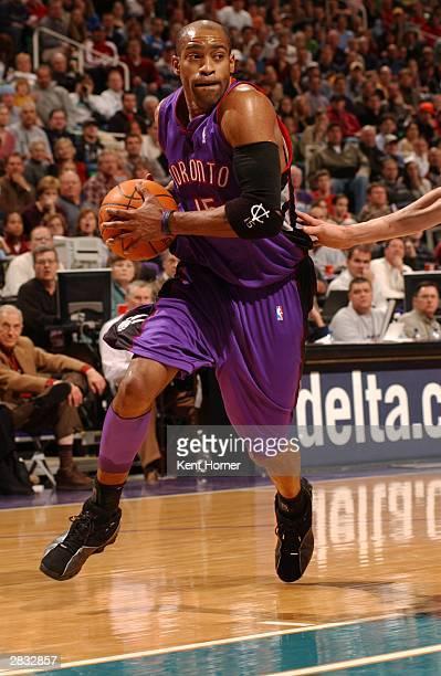 Vince Carter of the Toronto Raptors drive to the basket against the Utah Jazz on December 26, 2003 at the Delta Center in Salt Lake City, Utah. NOTE...