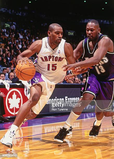 Vince Carter of the Toronto Raptors drives against Glenn Robinson of the Milwaukee Bucks on October 10 1999 at the Air Canada Centre in Toronto...