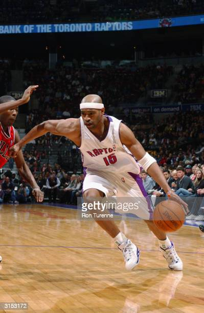 Vince Carter of the Toronto Raptors drives on Jamal Crawford of the Chicago Bulls during the game on March 19 2004 at the Air Canada Centre in...