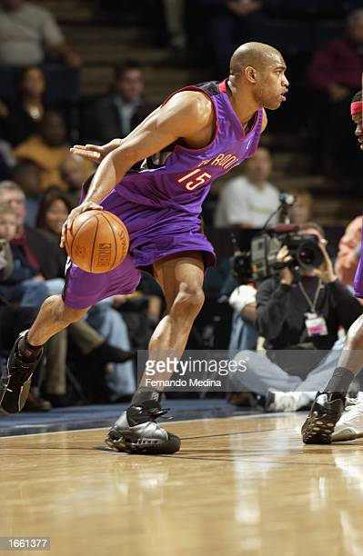 Vince Carter of the Toronto Raptors drives the ball during the NBA game against the Houston Rockets at Compaq Center on November 2 2002 in Houston...