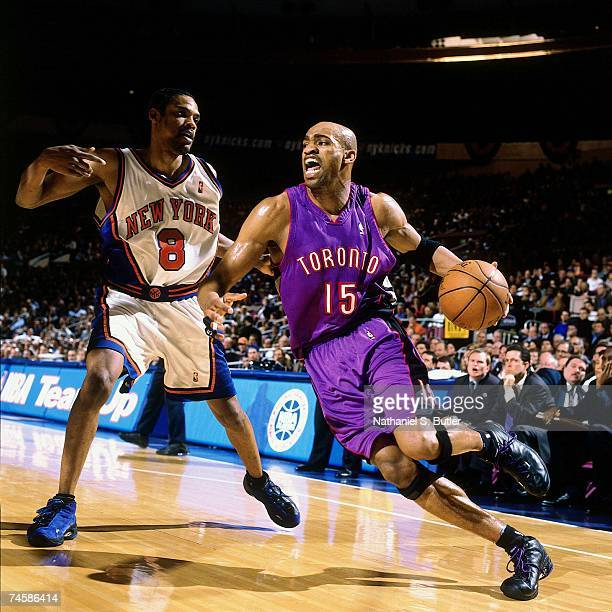 Vince Carter of the Toronto Raptors drives to the basket against Latrell Sprewell of the New York Knicks during a 2000 NBA game at Madison Square...
