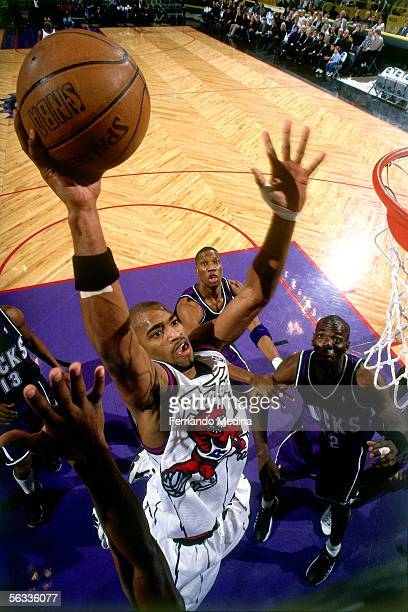 Vince Carter of the Toronto Raptors drives to the basket for a slam dunk against the Milwaukee Bucks during an NBA game on February 9, 1999 at Air...