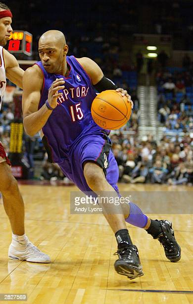 Vince Carter of the Toronto Raptors drives to the hoop as he is covered by Ira Newble of the Cleveland Cavaliers during the game at Gund Arena on...